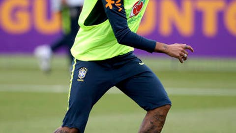 Brazil's Neymar controls the ball during a training session at Enfield Training Ground, London Thursday June 7, 2018 as they prepare for the upcoming soccer World Cup. (John Walton/PA via AP)