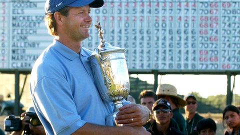 FILE - In this June 20, 2004, file photo, Retief Goosen, of South Africa, holds the U.S. Open Championship trophy at Shinnecock Hills Golf Club in Southampton, N.Y. The 2018 U.S. Open returns to Shinnecock Hills for the fifth time, June 14-17, 2018. Goosen did not qualify for this year's Open. (AP Photo/Charles Krupa, File)