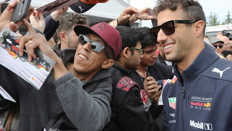 Red Bull Racing driver Daniel Ricciardo of Australia poses for photos during the open house day at the Canadian Grand Prix, Thursday, June 7, 2018 in Montreal. (Tom Boland/The Canadian Press via AP)