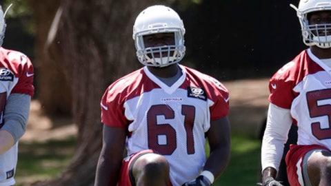 Arizona Cardinals' Mubarak Djeri (61) stretches during practice at the NFL football team's training camp Thursday, June 7, 2018, in Tempe, Ariz. (AP Photo/Matt York)