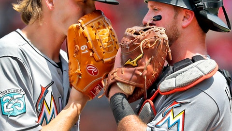 Miami Marlins relief pitcher Adam Conley, left, and catcher Bryan Holaday talk on the mound during the seventh inning of a baseball game against the St. Louis Cardinals Thursday, June 7, 2018, in St. Louis. (AP Photo/Jeff Roberson)