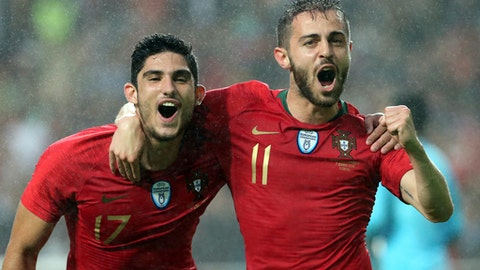 Portugal's Bernardo Silva, right, celebrates with Portugal's Goncalo Guedes after scoring his team opening goal during a friendly soccer match between Portugal and Algeria in Lisbon, Portugal, Thursday, June 7, 2018. (AP Photo/Armando Franca)