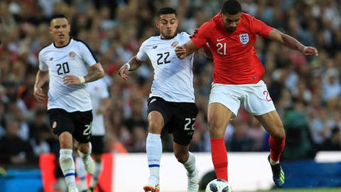 Costa Rica's Ronald Matarrita and England's Ruben Loftus-Cheek, right. battle for the ball during their International Friendly soccer match at Elland Road, Leeds, England, Thursday, June 7, 2018. (Mike Egerton/PA via AP)