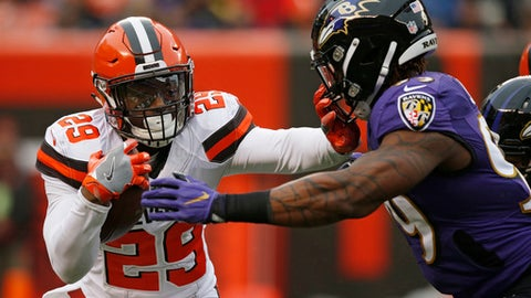 File-This Dec. 17, 2017, file photo shows Cleveland Browns running back Duke Johnson (29) trying to hold off Baltimore Ravens outside linebacker Matt Judon (99) during the first half of an NFL football game, in Cleveland.  Johnson has reached agreement with the Browns on a three-year, $15.6 million contract extension. Johnson was Clevelands top playmaker last season when the club went 0-16. The former third-round draft pick from Miami led the Browns with 74 catches and 693 yards receiving. He also rushed for 348 yards and scored four touchdowns. (AP Photo/Ron Schwane, File)