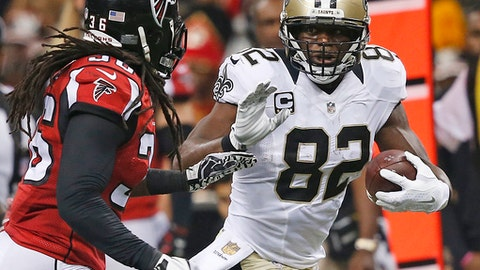 FILE - In this Oct. 15, 2015, file photo, New Orleans Saints' Benjamin Watson (82) looks to fend off Atlanta Falcons strong safety Kemal Ishmael (36) during the first half of an NFL football game in New Orleans. Watson wasnt a featured receiver in 2015 and wont likely be this season, either. Saints coach Sean Payton figures he can count on Watson being an exemplary leader in the locker room, a willing role player wholl rarely blow an assignmentand someone who remains skilled enough at age 37 to help Drew Brees punish defenses that pay too much attention to star play-makers such as receiver Michael Thomas and running back Alvin Kamara. (AP Photo/Gerald Herbert, File)