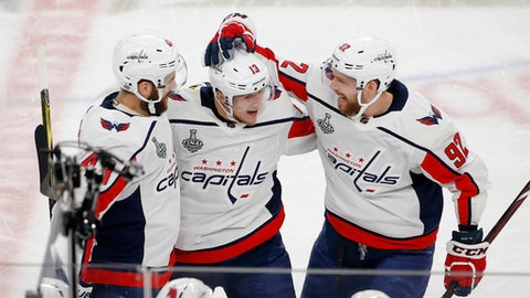 Washington Capitals left wing Jakub Vrana, center, celebrates his goal with right wing Tom Wilson, left, and center Evgeny Kuznetsov during the second period in Game 5 of the NHL hockey Stanley Cup Finals against the Vegas Golden Knights on Thursday, June 7, 2018, in Las Vegas. (AP Photo/Ross D. Franklin)