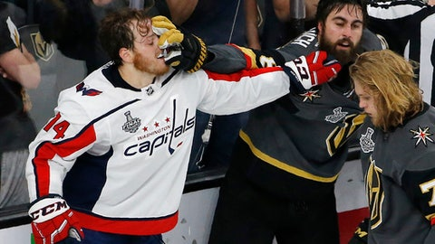 Washington Capitals defenseman John Carlson, left, and Vegas Golden Knights right wing Alex Tuch tussle during the second period in Game 5 of the NHL hockey Stanley Cup Finals on Thursday, June 7, 2018, in Las Vegas. (AP Photo/Ross D. Franklin)