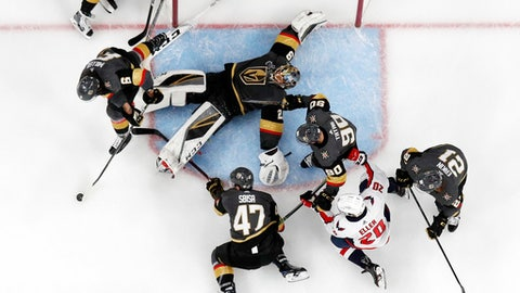Vegas Golden Knights goaltender Marc-Andre Fleury, top center, flops as he tries to stop a shot during the second period in Game 5 of the NHL hockey Stanley Cup Finals against the Washington Capitals on Thursday, June 7, 2018, in Las Vegas. (AP Photo/John Locher)