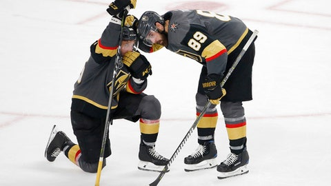 Vegas Golden Knights right wing Alex Tuch, right, consoles left wing Erik Haula after they lost to the Washington Capitals 4-3 in Game 5 of the NHL hockey Stanley Cup Finals Thursday, June 7, 2018, in Las Vegas. (AP Photo/Ross D. Franklin)