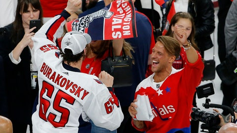 Washington Capitals' Andre Burakovsky (65) celebrates on the ice after the Capitals defeated the Vegas Golden Knights in Game 5 of the NHL hockey Stanley Cup Finals Thursday, June 7, 2018, in Las Vegas. (AP Photo/Ross D. Franklin)