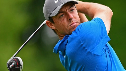 File- This June 1, 2018, file photo shows Rory McIlroy, from Northern Ireland, following his tee shot on the 18th hole during the second round of the Memorial golf tournament in Dublin, Ohio.  McIlroy has missed the cut four times in the U.S. Open, compared with once for the other three majors. He had least has a victory this year (Bay Hill) heading into the major season. Goes into this U.S. Open following more Augusta National disappointment, playing in the final group with Patrick Reed and shooting 74.  (AP Photo/David Dermer, File)