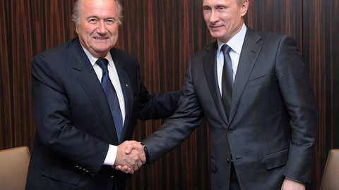 FILE - In this Thursday, Dec. 2, 2010 file photo, Russian Prime Minister Vladimir Putin, right, shakes hands with FIFA President Joseph Blatter after Russia was announced as the host for the 2018 soccer World Cup in Zurich, Switzerland. Vladimir Putin was only the prime minister of Russia, not president, when it won a 2018 World Cup hosting campaign that is still under criminal investigation. It was still clearly his victory in a campaign that got stronger through 2010 as Putin became more involved. (AP Photo/Kurt Schorrer, Pool, File)