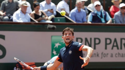 Austria's Dominic Thiem returns the ball to Italy's Marco Cecchinato during their semifinal match of the French Open tennis tournament at the Roland Garros stadium, Friday, June 8, 2018 in Paris. (AP Photo/Alessandra Tarantino)