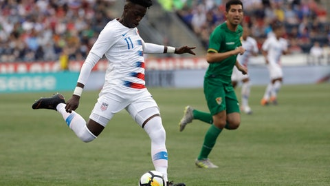 FILE - In this May 28, 2018, file photo, United States' Tim Weah moves the ball during an international friendly soccer match against Bolivia, in Chester, Pa. Weah is part of a young American roster brought in following the end of the Americans' streak of seven straight World Cup appearances. (AP Photo/Matt Slocum, File)