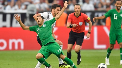 Saudi Arabia's Taisir Al-Jassim, front left, duels for the ball with Germany's Mats Hummels during a friendly soccer match between Germany and Saudi Arabia at BayArena in Leverkusen, Germany, Friday, June 8, 2018. (AP Photo/Martin Meissner)