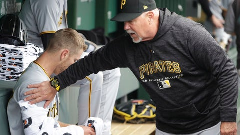 Pittsburgh Pirates pitching coach Ray Searage, right, pats starting pitcher Chad Kuhl on the arm after the fifth inning of a baseball game against the Chicago Cubs Friday, June 8, 2018, in Chicago. (AP Photo/Charles Rex Arbogast)