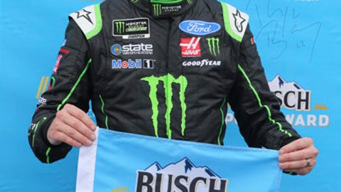 Kurt Busch smiles after winning the pole position for Sunday's NASCAR Cup Series auto race in Brooklyn, Mich., Friday, June 8, 2018. (AP Photo/Bob Brodbeck)