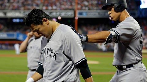 New York Yankees' Masahiro Tanaka, left, is patted on the back by teammate Aaron Judge after scoring a run on a sacrifice fly by Judge during the sixth inning of a baseball game against the New York Mets, Friday, June 8, 2018, in New York. (AP Photo/Adam Hunger)