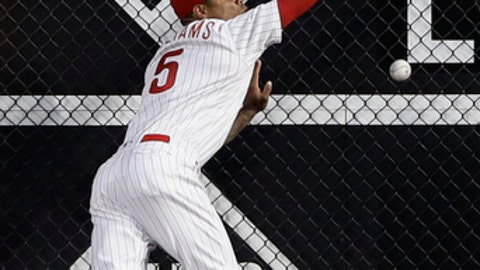 Philadelphia Phillies right fielder Nick Williams cannot catch a two-run double by Milwaukee Brewers' Jesus Aguilar during the fourth inning of a baseball game, Friday, June 8, 2018, in Philadelphia. (AP Photo/Matt Slocum)