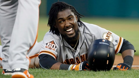 San Francisco Giants' Alen Hanson reacts after sliding safely into third base for a triple during the fourth inning of a baseball game against the Washington Nationals at Nationals Park, Friday, June 8, 2018, in Washington. (AP Photo/Alex Brandon)