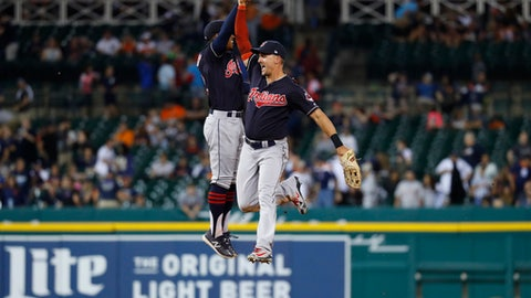 Cleveland Indians shortstop Francisco Lindor and Lonnie Chisenhall celebrate their 4-1 win against the Detroit Tigers after a baseball game in Detroit, Friday, June 8, 2018. (AP Photo/Paul Sancya)