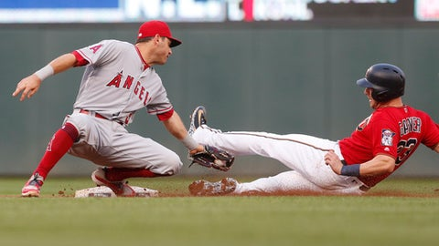 Los Angeles Angels second baseman Ian Kinsler, left, tags out Minnesota Twins' Mitch Garver at second in the second inning of a baseball game Friday, June 8, 2018, in Minneapolis. (AP Photo/Jim Mone)