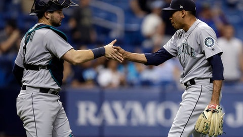 Seattle Mariners relief pitcher Edwin Diaz, right, shakes hands with catcher Mike Zunino after closing out the Tampa Bay Rays during the ninth inning of a baseball game Friday, June 8, 2018, in St. Petersburg, Fla. The Mariners won the game 4-3. (AP Photo/Chris O'Meara)