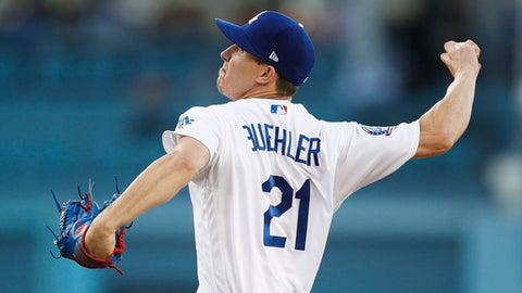 Los Angeles Dodgers starting pitcher Walker Buehler throws against the Atlanta Braves during the first inning of a baseball game, Friday, June 8, 2018, in Los Angeles. (AP Photo/Jae C. Hong)