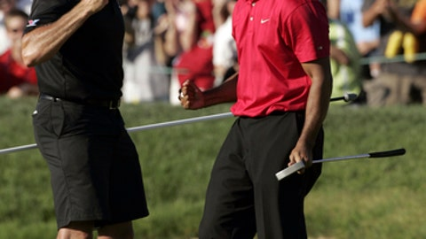 FILE - In this June 15, 2008, file photo, Tiger Woods celebrates with his caddie, Steve Williams, after sinking a birdie putt on the 18th green, forcing a playoff against Rocco Mediate, during the fourth round of the U.S. Open golf tournament at Torrey Pines in San Diego. Woods won the tournament, his most recent win in a major. (AP Photo/Chris O'Meara, File)