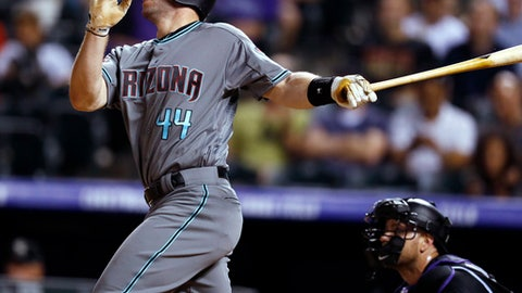 Arizona Diamondbacks' Paul Goldschmidt watches his solo home run off Colorado Rockies relief pitcher Brooks Pounders during the ninth inning of a baseball game Friday, June 8, 2018, in Denver. Arizona won 9-4. (AP Photo/David Zalubowski)