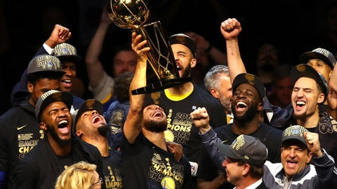 CLEVELAND, OH - JUNE 08:  Stephen Curry #30 of the Golden State Warriors celebrates with the Larry O'Brien Trophy after defeating the Cleveland Cavaliers during Game Four of the 2018 NBA Finals at Quicken Loans Arena on June 8, 2018 in Cleveland, Ohio. The Warriors defeated the Cavaliers 108-85 to win the 2018 NBA Finals. (Photo by Justin K. Aller/Getty Images)