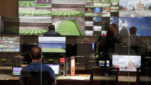Employees of the 2018 World Cup International Broadcast Centre (IBC) work at a facility of the centre in Moscow, Russia, Saturday, June 9, 2018. (AP Photo/Dmitri Lovetsky)