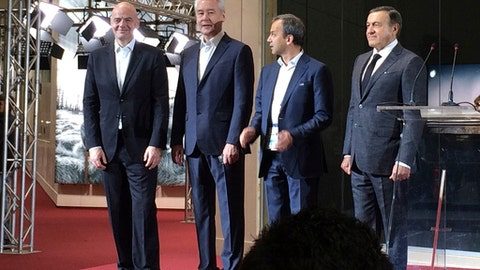 FIFA President Gianni Infantino, Moscow's Mayor Sergei Sobyanin, Russia's former Deputy Prime Minister Arkady Dvorkovich and President of Crocus Group Aras Agalarov take part in the official opening of the 2018 World Cup International Broadcast Centre (IBC) in Moscow, Russia, Saturday, June 9, 2018. (AP Photo/James Ellingworth)