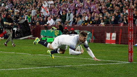 England's Elliot Daly scores a try during the first test rugby match between South Africa and England at Ellis Park stadium in Johannesburg, South Africa, Saturday, June 9, 2018. (AP Photo/Themba Hadebe)