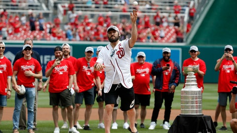 Washington Capitals' Alex Ovechkin, from Russia, throws out a second ceremonial first pitch before a baseball game between the Washington Nationals and the San Francisco Giants at Nationals Park, Saturday, June 9, 2018, in Washington. (AP Photo/Alex Brandon)
