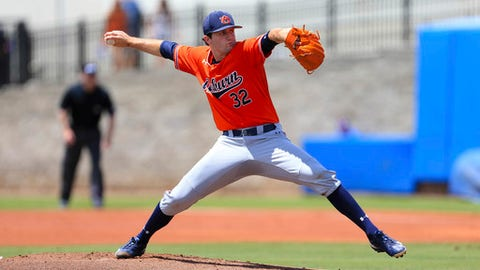 Auburn pitcher Casey Mize throws against Florida during the first inning of an NCAA Super Regional college baseball game Saturday, June 9, 2018, in Gainesville, Fla. (AP Photo/Matt Stamey)