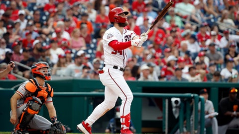 Washington Nationals' Bryce Harper watches his solo home run with San Francisco Giants catcher Nick Hundley during the fourth inning of a baseball game at Nationals Park, Saturday, June 9, 2018, in Washington. (AP Photo/Alex Brandon)