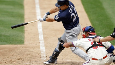 Milwaukee Brewers' Ji-Man Choi, left, follows through after hitting a grand slam off Philadelphia Phillies relief pitcher Luis Garcia during the sixth inning of a baseball game, Saturday, June 9, 2018, in Philadelphia. At right is catcher Jorge Alfaro. (AP Photo/Matt Slocum)