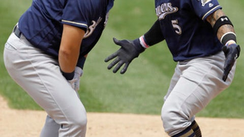 Milwaukee Brewers' Ji-Man Choi, left, celebrates with Jonathan Villar after Choi's grand slam off Philadelphia Phillies relief pitcher Luis Garcia during the sixth inning of a baseball game, Saturday, June 9, 2018, in Philadelphia. (AP Photo/Matt Slocum)