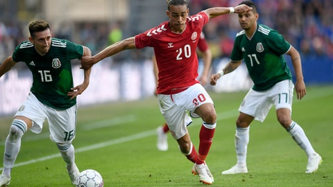 Denmark's Yussuf Yurary Poulsen, centre vies for the ball with Mexico's Hector Herrera and Jesus Manuel Corona,  during the friendly soccer match between Denmark and Mexico at Brondby Stadium, in Brondby,  Denmark, Saturday, June 9, 2018. (Lars Moeller/Ritzau Scanpix via AP)