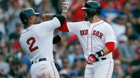 Boston Red Sox's J.D. Martinez celebrates his two-run home run that also drove in Xander Bogaerts (2) during the fifth inning of a baseball game against the Chicago White Sox in Boston, Saturday, June 9, 2018. (AP Photo/Michael Dwyer)