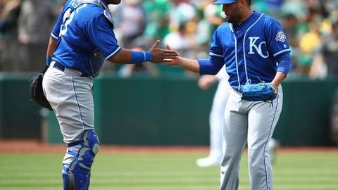 Kansas City Royals pitcher Kelvin Herrera, right, celebrates their win with Salvador Perez at the end of a baseball game against the Oakland Athletics, Saturday, June 9, 2018, in Oakland, Calif. (AP Photo/Ben Margot)