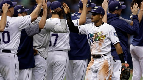 Tampa Bay Rays' Mallex Smith, right, high fives teammates after the Rays defeated the Seattle Mariners 7-3 during a baseball game Saturday, June 9, 2018, in St. Petersburg, Fla. (AP Photo/Chris O'Meara)