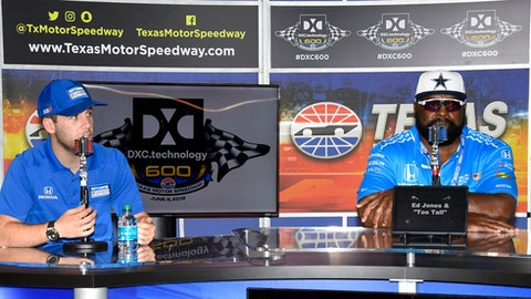 """IndyCar driver Ed Carpenter, left, and former Dallas Cowboy Ed """"Too Tall"""" Jones participate in a news conference before the IndyCar auto race Saturday, June 9, 2018, in Fort Worth, Texas. (AP Photo/Larry Papke)"""