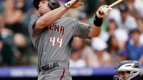 Arizona Diamondbacks' Paul Goldschmidt watches his three-run home run off Colorado Rockies starting pitcher Chad Bettis during the fourth inning of a baseball game Saturday, June 9, 2018, in Denver. (AP Photo/David Zalubowski)