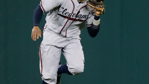 Cleveland Indians' Rajai Davis catches a fly ball hit by Detroit Tigers' Dixon Machado for the final out of the 11th inning of a baseball game Saturday, June 9, 2018, in Detroit. The teams are honoring the Negro Leagues by wearing Detroit Stars and Cleveland Buckeyes uniforms. (AP Photo/Duane Burleson)