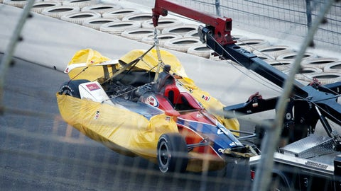 Matheus Leist's car is hauled to the garage during the IndyCar auto race Saturday, June 9, 2018, in Fort Worth, Texas. (AP Photo/Brandon Wade)