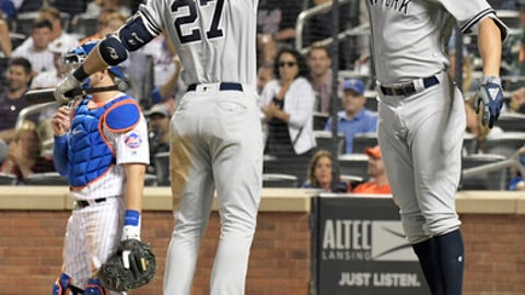 New York Yankees' Aaron Judge, right, celebrates his home run with teammate Giancarlo Stanton (27) during the eighth inning of a baseball game against the New York Mets, Saturday, June 9, 2018, in New York. (AP Photo/Bill Kostroun)