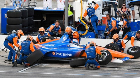 Scott Dixon, of New Zealand, makes a pit stop during the IndyCar auto race Saturday, June 9, 2018, in Fort Worth, Texas. (AP Photo/Larry Papke)