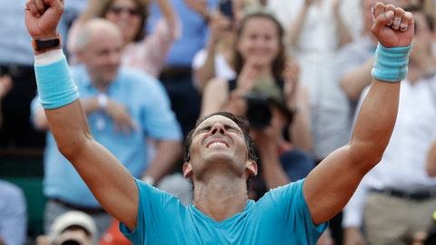 Spain's Rafael Nadal celebrates winning the men's final match of the French Open tennis tournament against Austria's Dominic Thiem in three sets 6-4, 6-3, 6-2, at the Roland Garros stadium in Paris, France, Sunday, June 10, 2018. (AP Photo/Alessandra Tarantino)